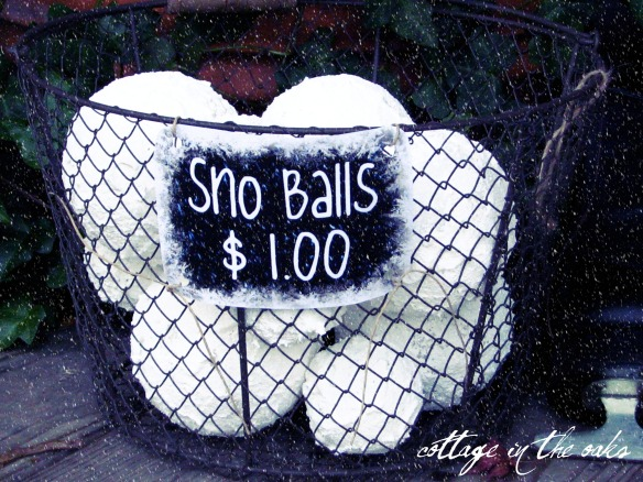 snow balls on porch in basket