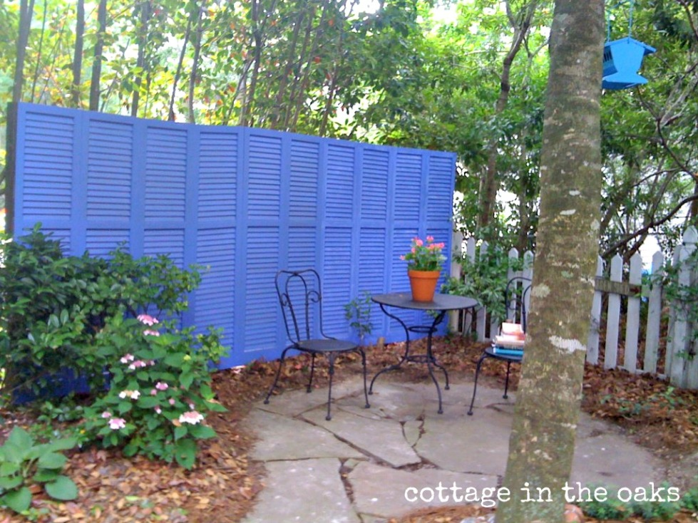 repurposed shutters as garden screen