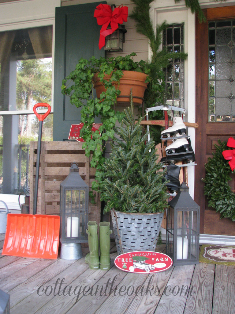 christmas front porch 2012 cottage in the oaks christmas tree in olive bucket